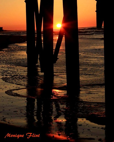 ocean sky orange sun reflection beach water weather sunrise pier shore weatherphotography