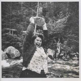 Woman lifting a rock above her head | by simpleinsomnia