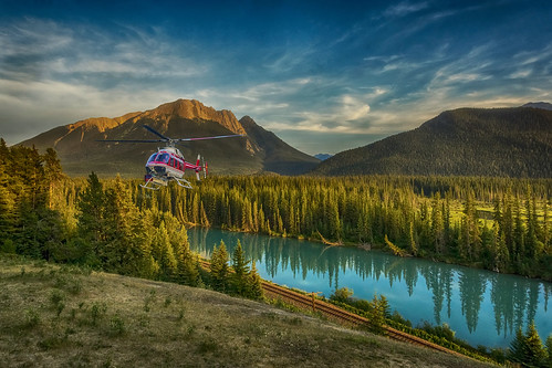 banff alberta sony goldenhour sun sky sunset river reflection nature bright blue contrast color colors colours colour clouds cloud canada dusk forest green landscape light mountain outdoors outdoor rock tree trees wimvandem water helicopter photo composite tistheseason