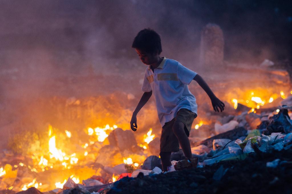 Boy Playing in Trash Fire, Cebu City Philippines | Taken at … | Flickr