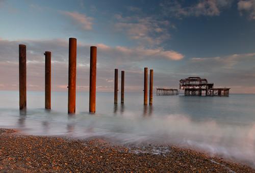 sunset sea sky west water clouds pier brighton warmth