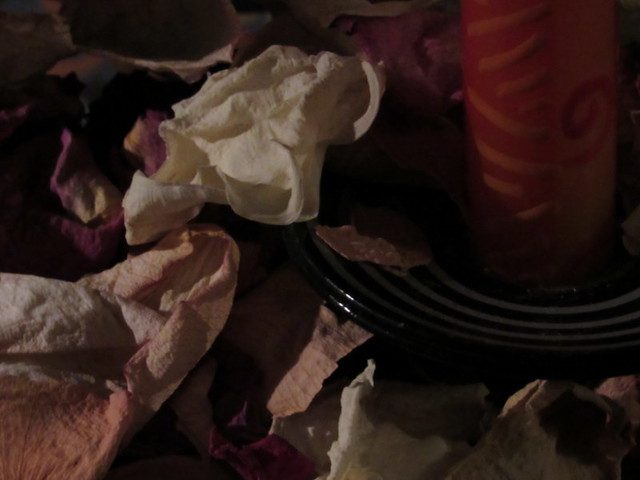 Faded rose petals and candles
