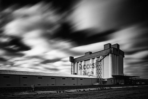 longexposure sky blackandwhite bw monochrome architecture clouds us blackwhite industrial texas unitedstates rice houston warehouse cotton silos tiltshift artiststudios successrice artsdisctrict canontse24mmf35lii silosonsawyer riviniafoods