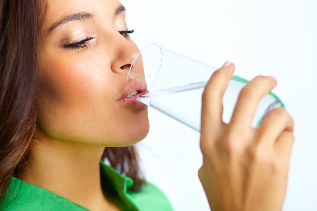 Close-up of pretty girl drinking water from glass - How To CURE HEARTBURN During Pregnancy Naturally & Easily Prevent ACID REFLUX Too!!!