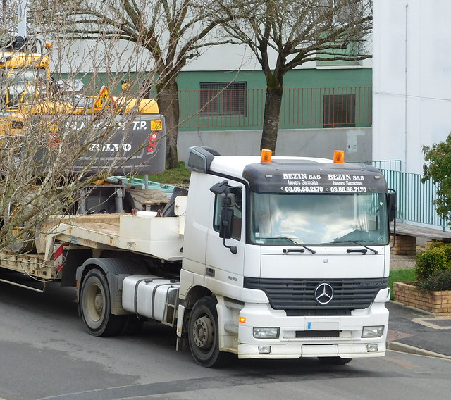 Mercedes-Benz Actros 1840 with semi-trailer and Volvo excavator