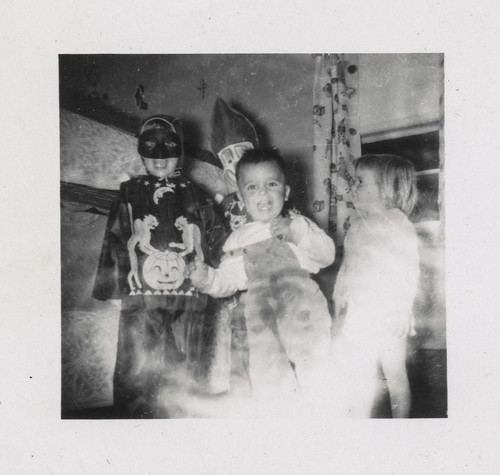 Grungy photo of children in Halloween costumes