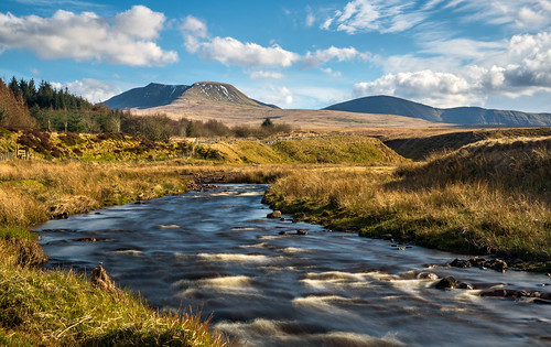 blue trees sky mountain grass yellow wales clouds forest river landscape spring view breconbeacons rapids brecon