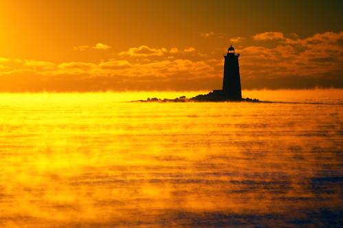 ocean orange usa water yellow sunrise newcastle dawn maine newhampshire seasmoke kittery whaleback wintersea piscataqua piscataquariver whalebacklight whalebacklighthouse whalebackledge wbnawneme