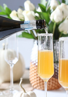 pouring champagne sparkling wine into flute glass | by Berries.com