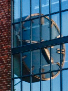 Clock on the bright side. Reflection of the Kockums' Clock in Malmö Sweden
