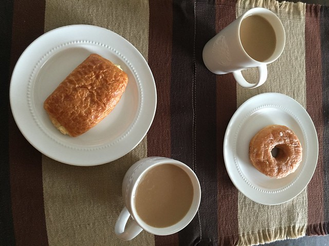 We woke up late so I guess this is brunch. Honey glazed donut and pastry with cream cheese and piping hot coffee. But will slice fruits to complete the table setting. #lazySundays.