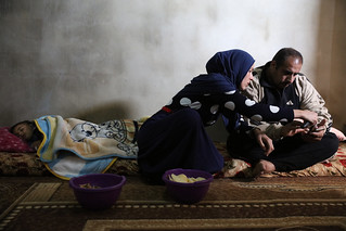 Ghada and her husband Imad look at family photos | by World Bank Photo Collection