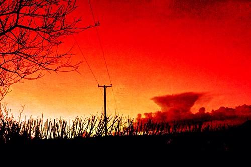 irish ireland cork newmarket processed clouds sky red silhouettes sunset sliderssunday iphone5 distressedfx painteresqueapp hss htt nwn cumulonimbusincus