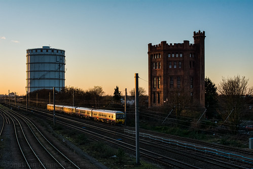 southallwatertower watertower tower castle southallgasworks gasholder gasometer railway greatwesternrailway train sunset twilight dusk tracks southall middlesex londonboroughofealing london england uk unitedkingdom nikon d7100 nikond7100