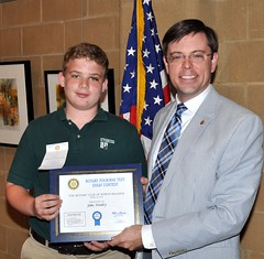 Pictured with Club President Chris Morden is the 3rd Place winner of this year's 4 Way Test Essay Contest Jake Pendry.. Jake is a student at St. Raphael's Catholic School.