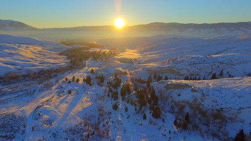 sunset usa sun sunlight mountains art nature sunshine forest landscape unmodified haze unitedstates offroad artistic snowy bluesky hills idaho lensflare vista northamerica rockymountains backroad epic baretrees pinetrees snowcovered sunflare clearblueskies unedited mountainscape drone nofilters bitterrootmountains noadjustments dji beaverheadmountains straightoffthecamera lemhimountains quadcopter lemhivalley illuminatedlandscape phantom3professional kirtleycreekroad
