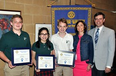 All 3 winners of the 4 Way Test Essay contest pose with their faculty adviser Ms. Winnie Reilly and Rotary Club President Chris Morden.