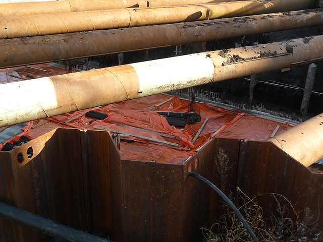 2015.01 - Amsterdam photo of a rusty Still-life - construction-site for building with concrete pilings in the waterlogged soil of my city; a geotagged free urban picture, in public domain / Commons CCO;  city photography by Fons Heijnsbroek, Netherlands