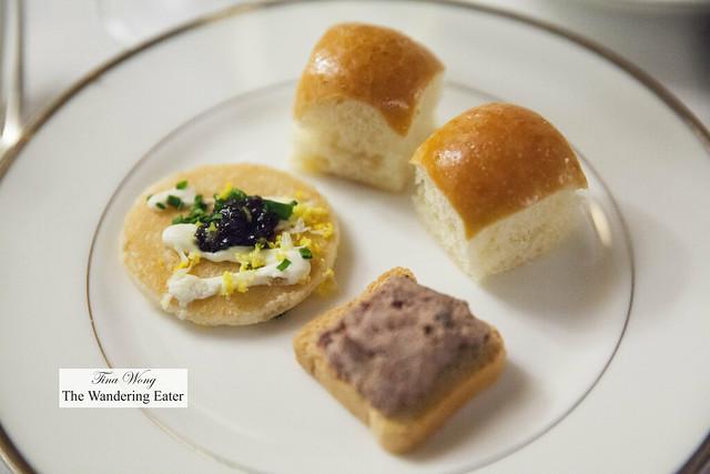Caviar blini, Foie gras canapé, mini broiche buns filled with dill, egg and cornichon salad