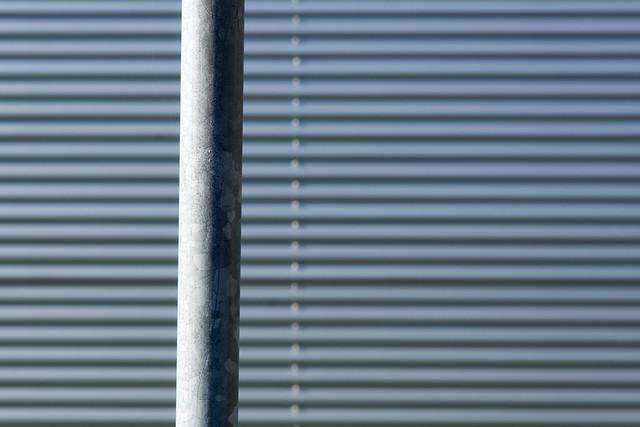 Grey pole and wall