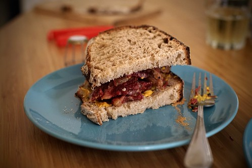 Montreal smoked meat sandwich in rye flour bread with yellow mustard | by Cedric Sam