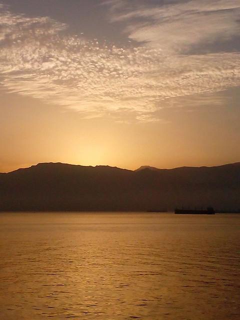 U.A.E-port of.Mina.Saqr- gold.ship.sky-march2016-sunrise--Samir.Ketf