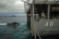An amphibious assault vehicle approaches USS Ashland (LSD 48) during the 31st Marine Expeditionary Unit onload in Okinawa.  (U.S. Marine Corps/Cpl. Thor J. Larson)