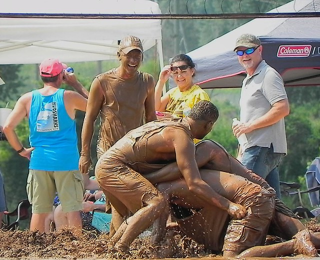 Mud Volleyball or Mud Wrestling