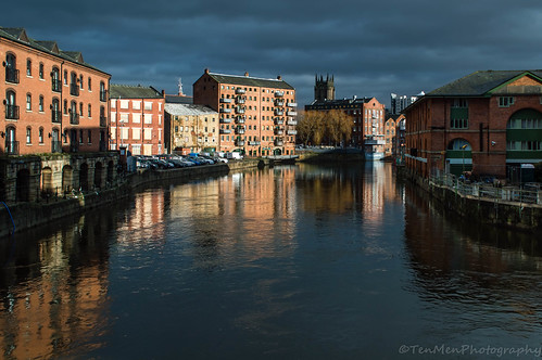city reflection church sunshine clouds buildings river canal leeds