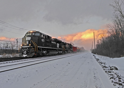 winter sunsets railroadtracks norfolksouthern penncentral winterphotography sunsetphotography norfolksoutherntrains nschicagoline ns1073 winterontherailroad winterandrailroads winterrailroadphotography nspenncentralheritagelocomotive
