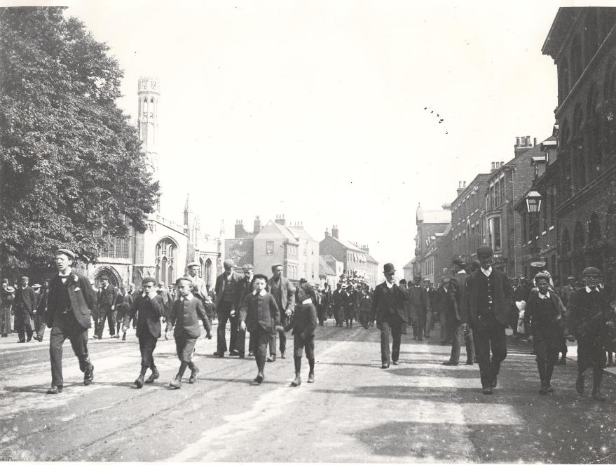 Schoolboys walking past St Marys Church, Beverley c.1900s (archive ref DDPD-2-1-19)