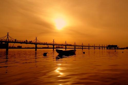 sunset sun nature water reflections river landscape pier boat jetty silhouettes poland polska wisła vistula płock