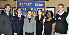 Far left Club President Chris Morden and far right Jason Potts the club's Youth Service Chairman. In between from left to right: 1st place winner: Andrew Smith, 2nd place winner Maddie Pare, 3rd place winner Emma Fagnano, 4th place winner Lakeeta Lockett. All are students at Sanderson High School.