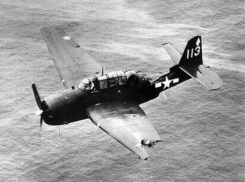 A damaged Avenger returns to USS Bennington after a strike on Chichi Jima