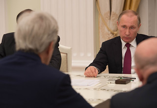 Russian President Putin Listens as Secretary Kerry Speaks During Their Bilateral Meeting Focused on Syria and Ukraine in Moscow | by U.S. Department of State
