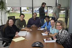 Tue, 2015-11-17 19:03 - Jeanette, Lisa, and camera man, Jason York (next to Jeanette) are extras at a conference where contamination in the production suite is being discussed. Also seated at the table are the actors who play roles as the production team in our imaginary company, Franklin Biologics. We are all smiling now but we were quite serious about this contamination during our meeting.