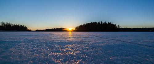sunset sun lake ice espoo finland lens landscape prime spring sundown anamorphic järvi jää auringonlasku aurinko uusimaa kevät 14mm pitkäjärvi laaksolahti