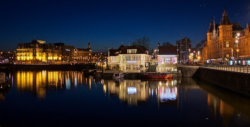 amsterdam canals night lights reflections saariysqualitypictures holland trainstation netherlands