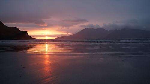 Island sunset reflecting onto the beach in Scotland | by strangesimon