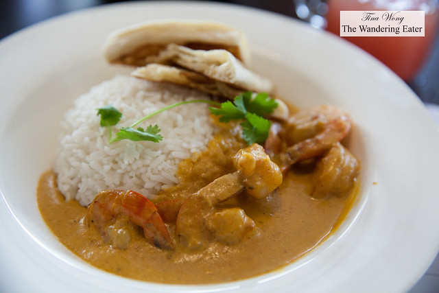 Coconut shrimp curry with naan and white rice