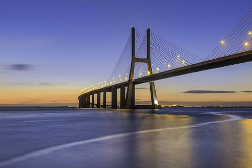 longexposure bridge blue sunrise river gold lights lisboa lisbon s ponte bluehour magical tejo tajo vascodagama