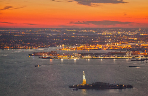 nyc newyorkcity sunset sky orange sun newyork water statue river observation island lights freedom harbor worldtradecenter landmark deck historical wtc statueofliberty immigration ladyliberty oneworldtrade