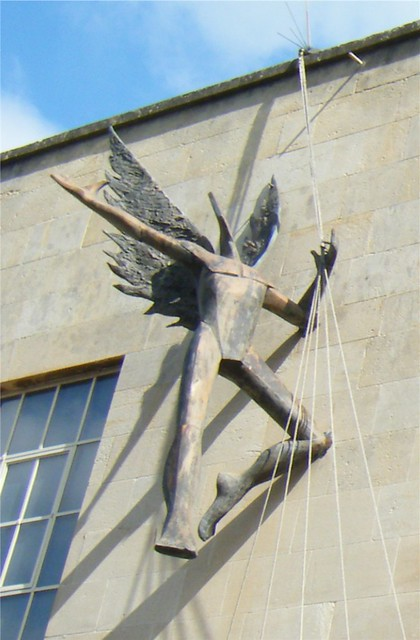 City of Bath, England, unusual wall hanging statue outside on the Ustinov Studio building, Theatre Royal