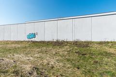 Die fast leere Wand