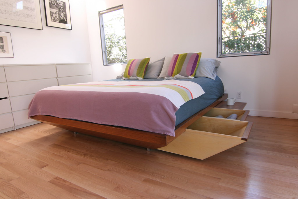 Slide out storage built into the bed frame