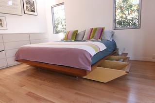 Slide out storage built into the bed frame | by Jeremy Levine Design