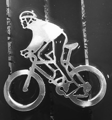 """This bicycle is 2 1/2 inches wide and 1 1/2"""" tall. The tolerances on our waterjet are so precise we can cut .015 cutting stream at 50,000 psi."""