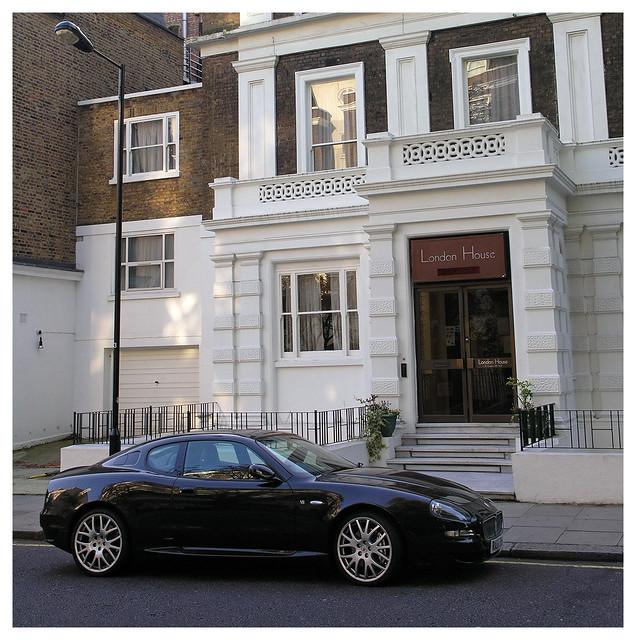 London House and a black Maserati