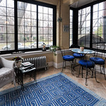 A mosaic bistro table and abundant windows give this Evanston room a basket of pastries cozy vibe.