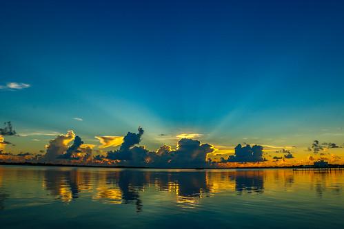 blue sky usa sun seascape nature water weather st clouds sunrise canon river outside photography photo florida cloudy bluesky stuart photograph rays lucieriver canon70d downtownoutdoors